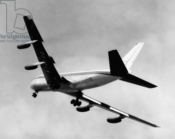 Low angle view of an airplane in flight, Boeing 707