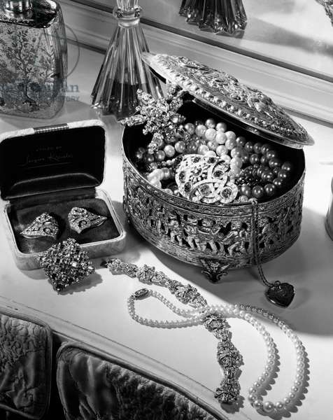 Close-up of jewelry with jewelry box on a table