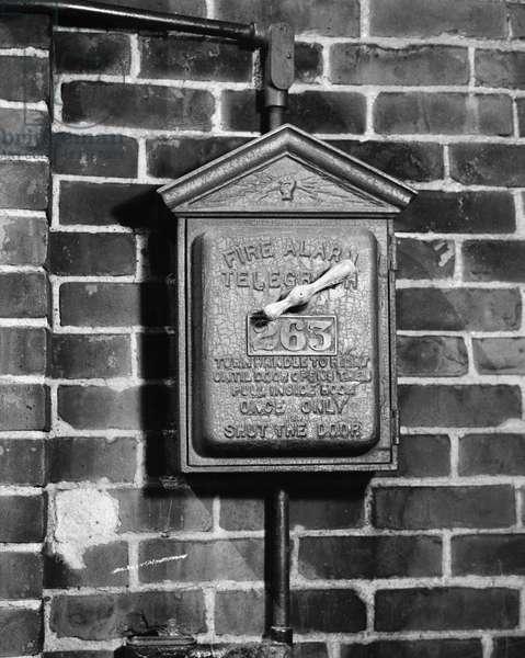 Fire alarm on a brick wall