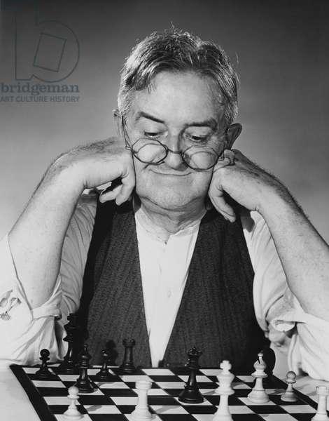 Close-up of a senior man playing chess