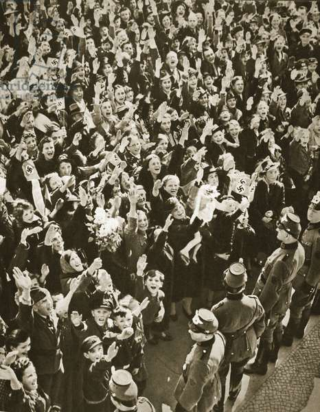 A crowd cheering and saluting Adolf Hitler (b/w photo)