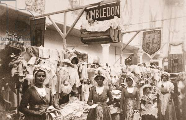 The stand of the Wimbledon branch of the WSPU at the Christmas Bazaar located in the Portman Rooms, 1911 (sepia photo)
