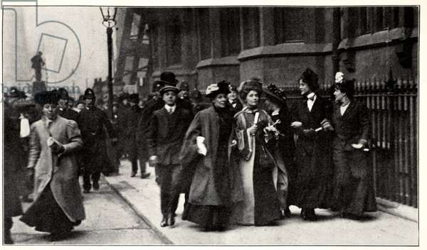 Emmeline Pankhurst carrying a petition from the Third Women's Parliament to the Prime Minister on February 13th, 1908 (b/w photo)
