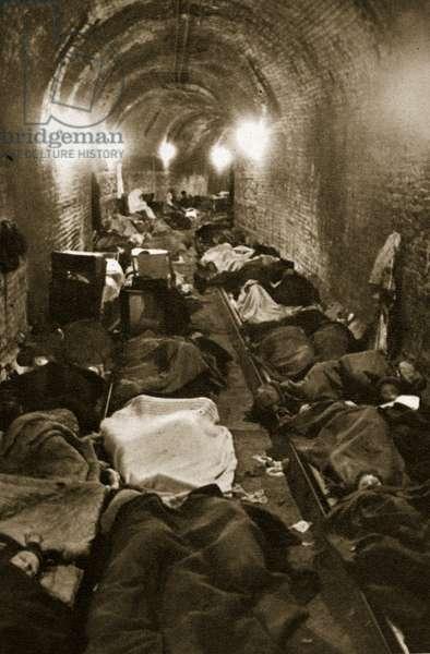 Residents of Le Havre seek refuge in the train tunnels, September 1940 (b/w photo)