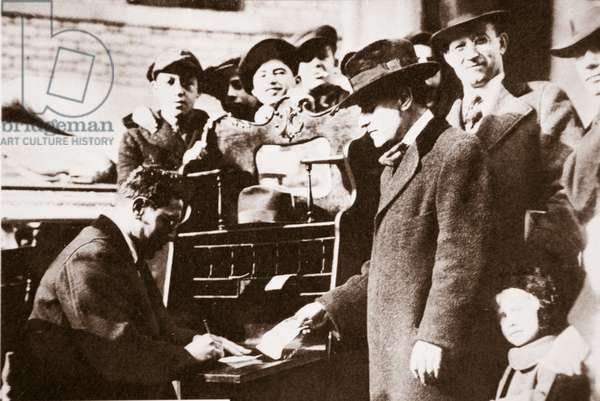 Head of the Anti-Rent League enrolling new members in New York early 1919 (sepia photo)