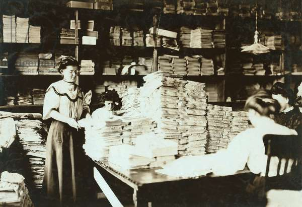 Young women sorting papers in a storeroom, c.1905 (b/w photo)