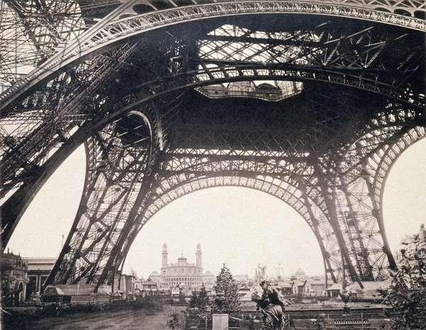Under the Eiffel Tower, before ascending, from 'L'Album de l'Exposition 1889' by Glucq, Paris 1889 (litho)