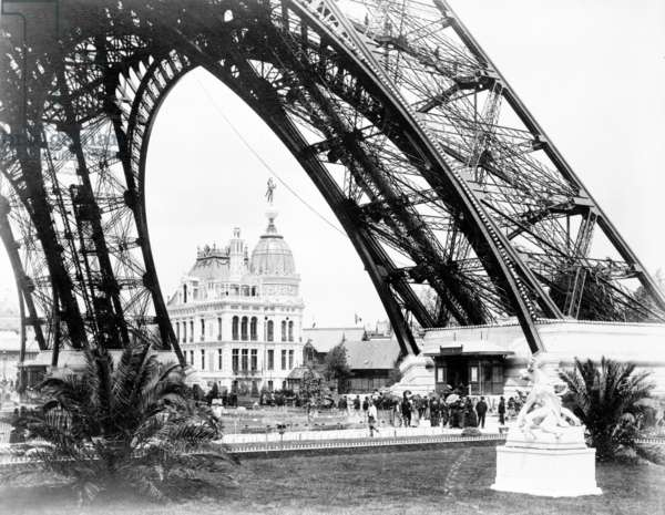 The Gas Pavilion seen through the base of the Eiffel Tower, Paris Exhibition,  1889 (b/w photo)