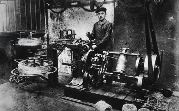 The Manufacture of Barbed Wire- the Machine for fixing on the Barbs at its work, from 'The Illustrated War News' (sepia photo)
