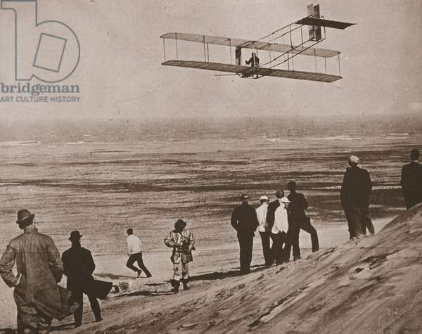 The Wright Brothers testing an early plane at Kitty Hawk, North Carolina (sepia photo)