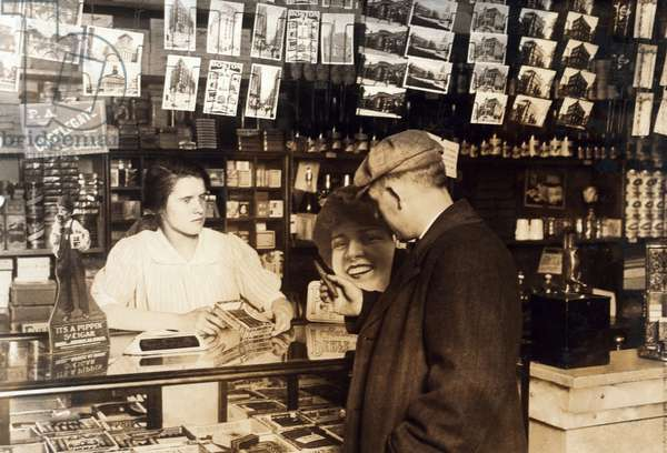 Mary Creed, aged 14, selling cigars, c.1930 (b/w photo)