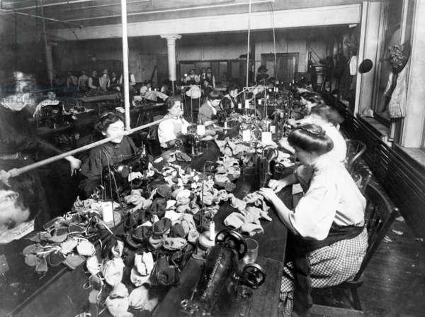 Women sewing teddy bears in a factory, c.1915 (b/w photo)