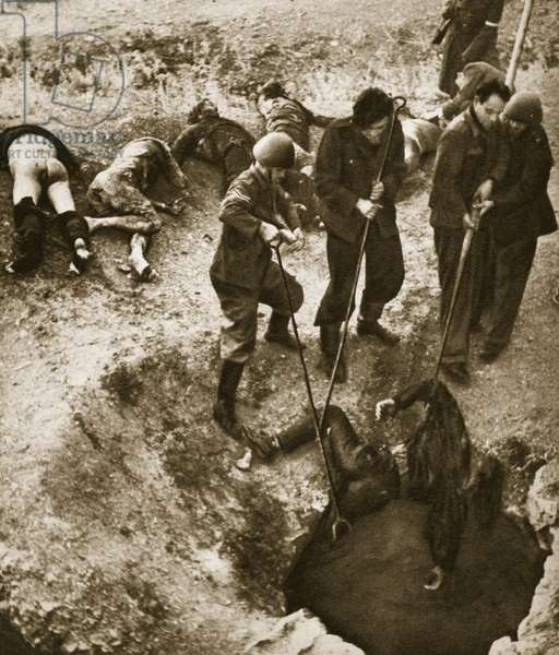 The bodies of Greek civilians are pulled from a well shaft, 1944 (b/w photo)