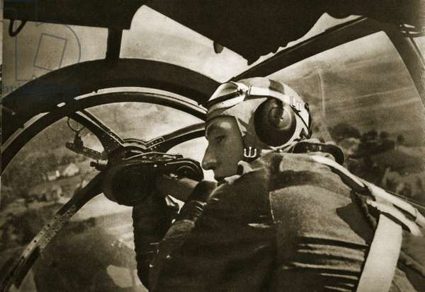 Observer in the pivotable machine-gun post in a German fighter plane, 1939 (b/w photo)
