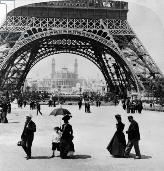 Looking through the base of the  Eiffel tower to the Trocadero and Colonial station, Paris Exhibition, 1900 (b/w photo)
