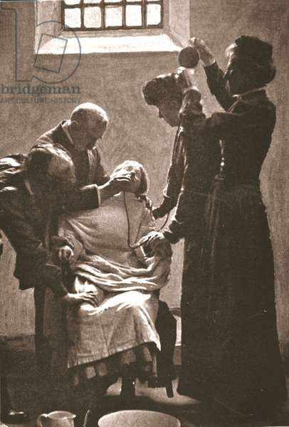 Suffragette being force fed with the nasal tube in Holloway Prison, 1909 (sepia photo)