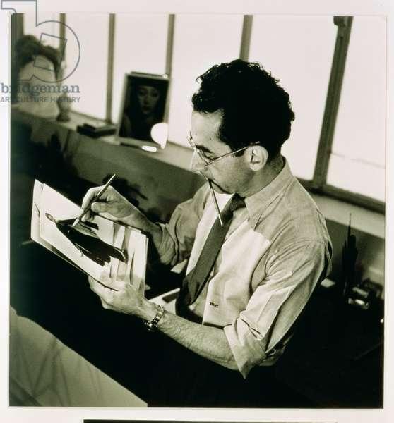 Man Ray retouching a fashion print, 20th century (photo)