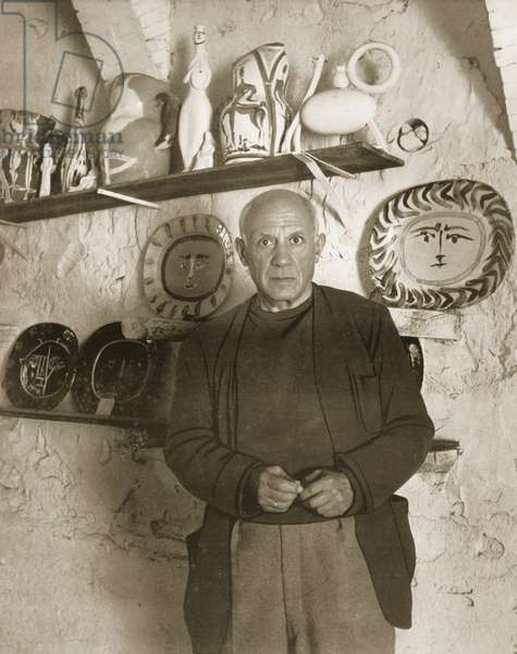 Picasso in his pottery workshop, c.1946-48 (b/w photo)