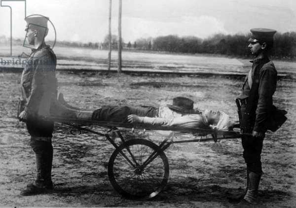 Injured soldier on a make-shift stretcher with wheels, c.1914-18 (b/w photo)