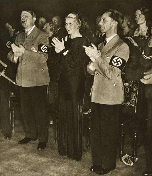 Adolf Hitler, Magda Goebbels and Dr. Joseph Goebbels at a concert (b/w photo)