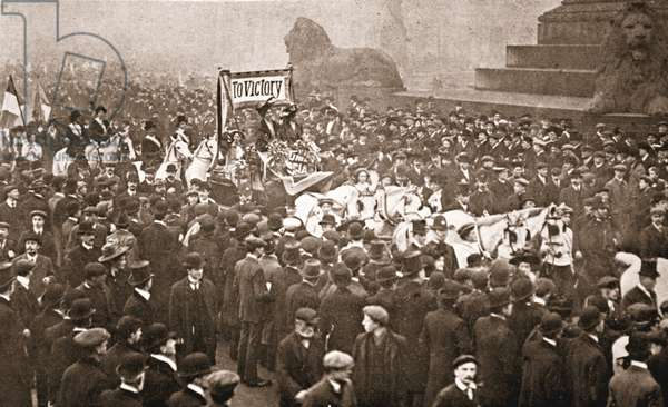 Procession to welcome Emmeline Pankhurst, Christabel Pankhurst and Mary Leigh on their early release from prison on 19th December 1908 (sepia photo)