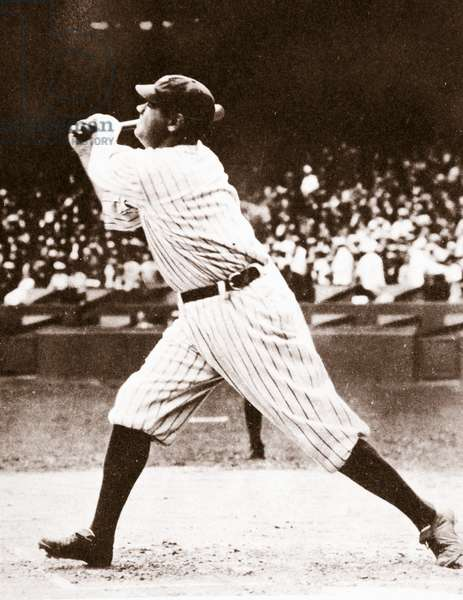 Babe Ruth shown here putting formidable weight behind a strike (b/w photo)