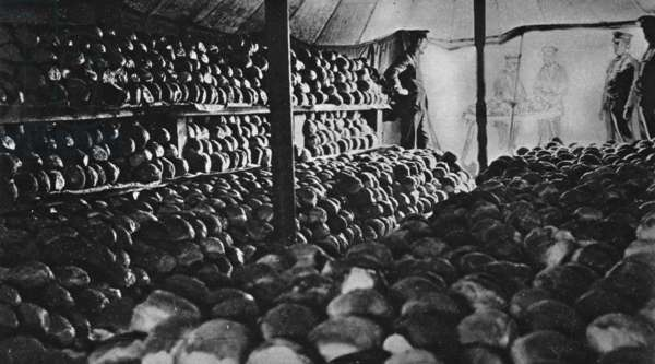 In a British camp at Salonika: part of one day's bread-ration supply ready in a commissariat tent, from 'The Illustrated War News' (b/w photo)