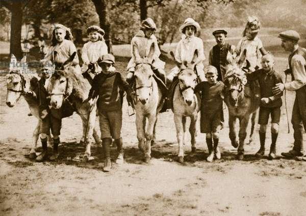 Children Donkey riding on Hampstead Heath (sepia photo)