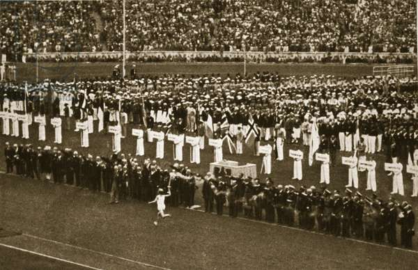 The last man in the great Olympic relay carries the torch to light the flame in the cauldron, 1936 (b/w photo)
