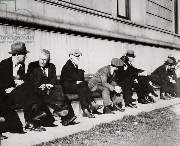Unemployed men sitting on the sunny side of the Public Library in San Francisco, February 1937 (b/w photo)