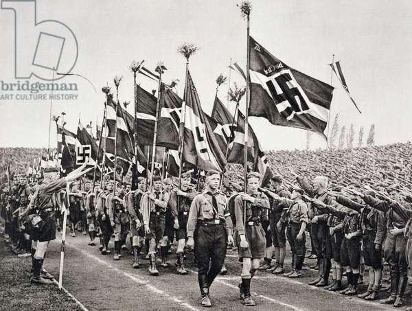 A Hitler Youth rally on National Socialist Party Day in the Nuremberg Ring, 1933, from 'Deutsche Gedenkhalle: Das Neue Deutschland' compiled by General Von Eisenhart Rothe, 1939 (photogravure)