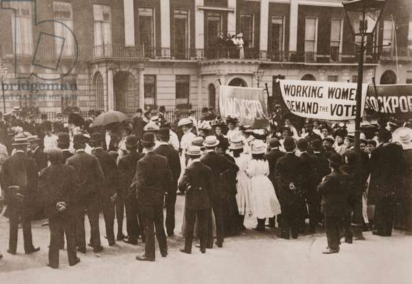 Spectators gather on Portland Place to watch the Women's Sunday procession, 21st July 1908 (sepia photo)