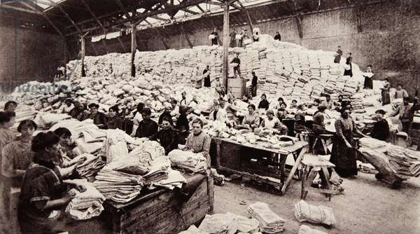 A centre for French 'Sister Susies', at one of the army shirt distributing depots, from 'The Illustrated War News' (b/w photo)
