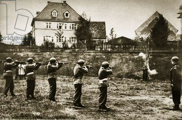 A German saboteur is shot by an American firing squad, Germany, 1945 (b/w photo)