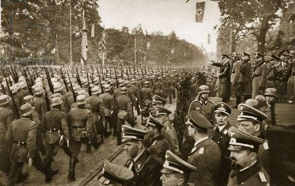 The German infantry parade past Adolf Hitler on Ujazdowskie Avenue, Warsaw, 1939 (b/w photo)