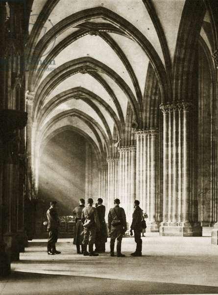 Strasbourg was occupied on 19th June: German soldiers look round Erwin von Steinbach's Strasbourg Cathedral, 1940 (b/w photo)
