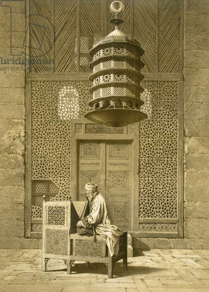 Cairo: Funerary or Sepuchral Mosque of Sultan Barquoq seated Imam reading the Koran, before a pierced screen c14th, 19th century (print)