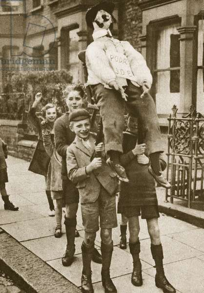 Children carrying a 'Guy Fawkes' on Bonfire Night (sepia photo)