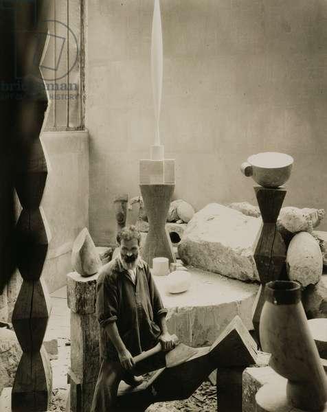 Constantin Brancusi (1876-1957) in his Studio, 1927 (b/w photo)