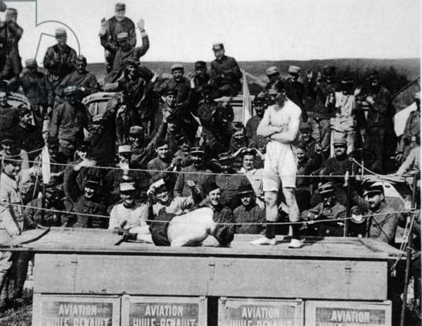 Carpentier gives the knock-out at the front: the famous boxer puts on the gloves again, to honour a hero, from 'The Illustrated War News' (b/w photo)