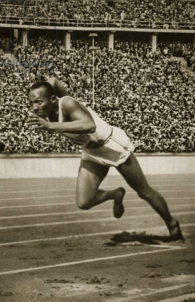 Jesse Owens at the start of the 200m race at the 1936 Berlin Olympics (b/w photo)