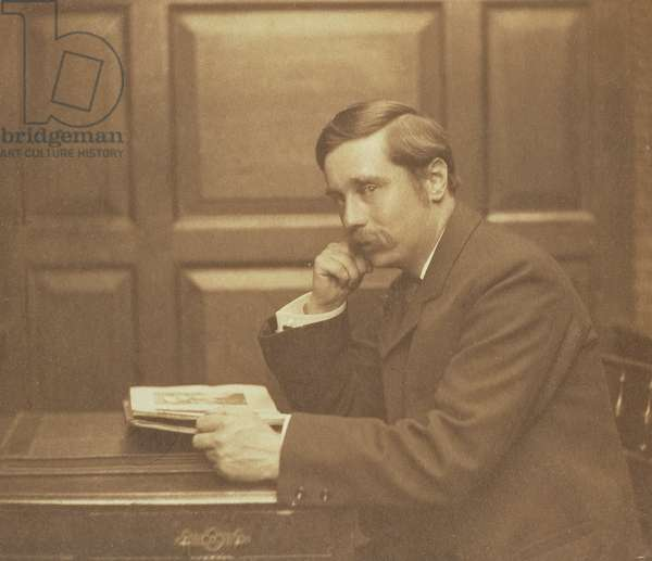 Portrait photograph of Herbert George Wells (1866-1946) by Frederick Hollyer (1837-1933) 1903 (sepia photo)