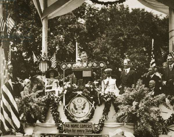 Lindbergh addressing a crowd at the Washington Monument, after accepting the Distinguished Flying Cross from President Coolidge, 1927 (b/w photo)