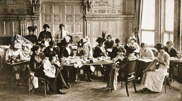 Woman and the Great War: a Ladies Red Cross sewing meeting in a great London hotel, a scene typical of scores, from 'The Illustrated War News' (b/w photo)