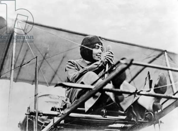 Hélène Dutrieu at the controls of her plane, pub. c.1911 (b/w photo)