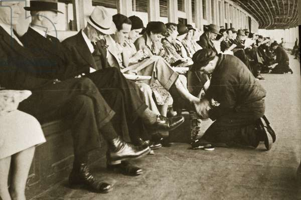 Shoe shiners on board the Staten Island Ferry, New York (sepia photo)