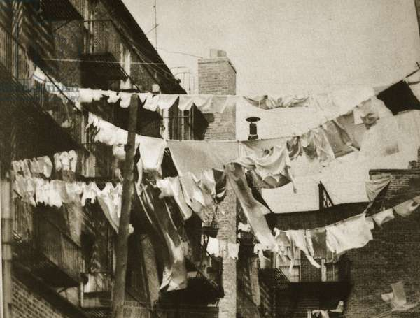 Wash day at some New York tenement buildings (sepia photo)