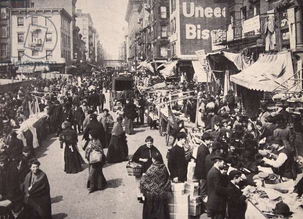 On New York's East Side Immigrants collected in numbers at Bowery, buying and selling, 1900s (b/w photo)