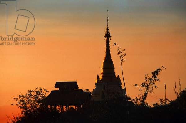 A Pagoda silhouetted at Sunset, Mrauk U (photo)