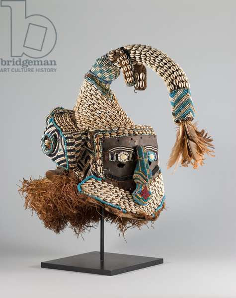 Helmet Mask (mukenga), C20th (cloth with cowrie shells, glass beads, iron, feathers, raffia, wood, and cane)